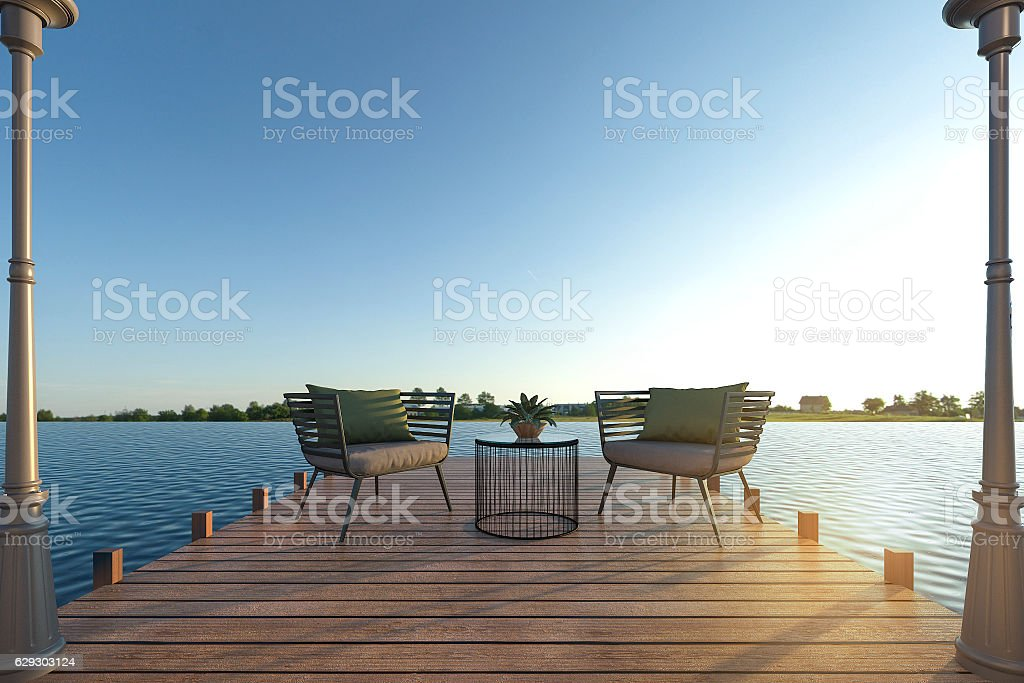 3d rendering beach armchair set on wood terrace near sea stock photo