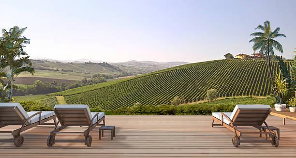 3d rendering beautiful beach bed on terrace near green hill - italienische lebensart stock-fotos und bilder
