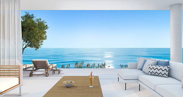 3d rendering contemporary nice living room near beach - villa stock photos and pictures