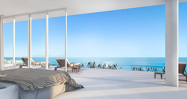 3d rendering luxury villa bedroom near beach stock photo