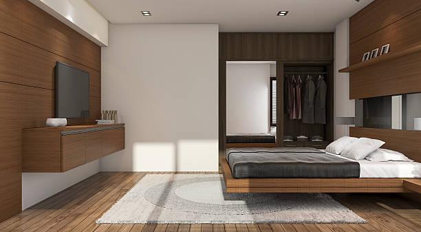 3d rendering nice contemporary wood bedroom with tv and closet - laminatschränke stock-fotos und bilder