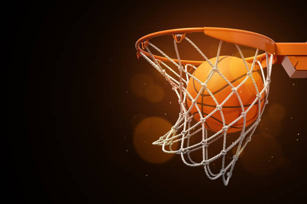3d rendering of a basketball in the net on a dark background. - basket foto e immagini stock