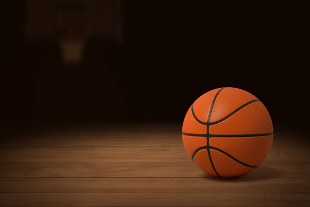 3d rendering of a basketball on the wooden floor of a dimly lit gym. - dimly stock pictures, royalty-free photos & images