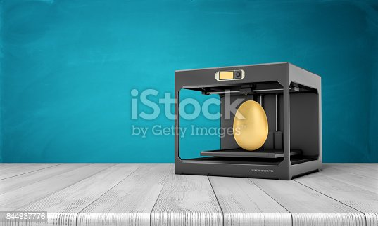 istock 3d rendering of a black 3d-printer standing on a wooden table with a finished golden egg inside it 844937776