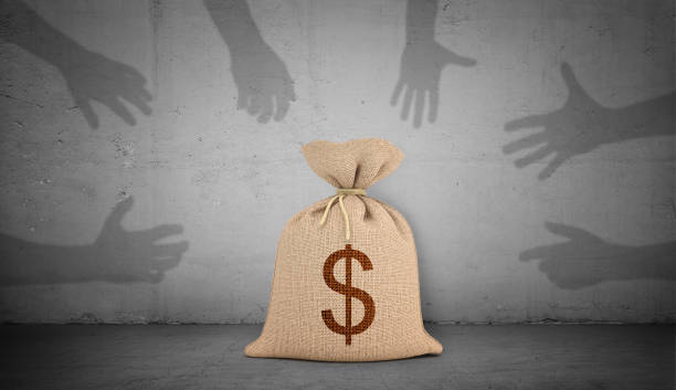 3d rendering of a brown money bag with a dollar sign stands on concrete background with many shadow hands grabbing and pointing at it. 3d rendering of a brown money bag with a dollar sign stands on concrete background with many shadow hands grabbing and pointing at it. Money and income. Lottery prize. Corrupting money. greed stock pictures, royalty-free photos & images