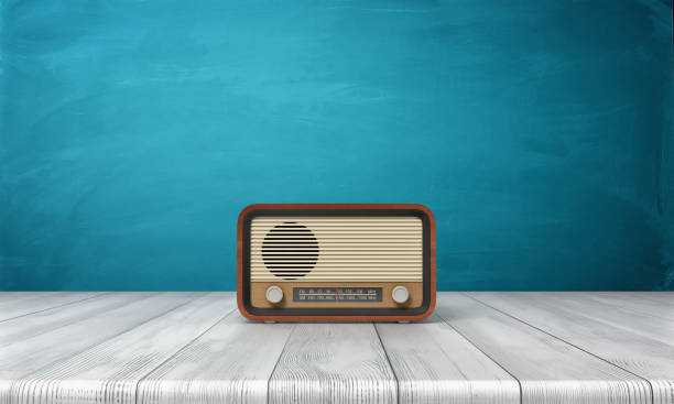 3d rendering of a brown vintage radio set standing on a white wood table in front of blue background - radio station stock photos and pictures