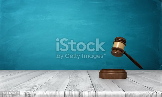 istock 3d rendering of a brown wooden judge gavel and sound block lying on a wooden table against blue background 841426026