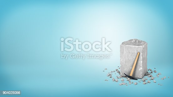 istock 3d rendering of a large grey piece of rough grey stone with a small hammer leaning on it on blue background 904025056