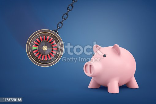 3d rendering of a large round casino roulette swinging on a metal chain near a big pink piggy bank. Money and gambling. Betting real money. Empty bank after casino.