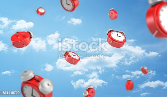 istock 3d rendering of a many red retro-looking alarm clocks with metal bells fall down on cloudy sky background 851419722