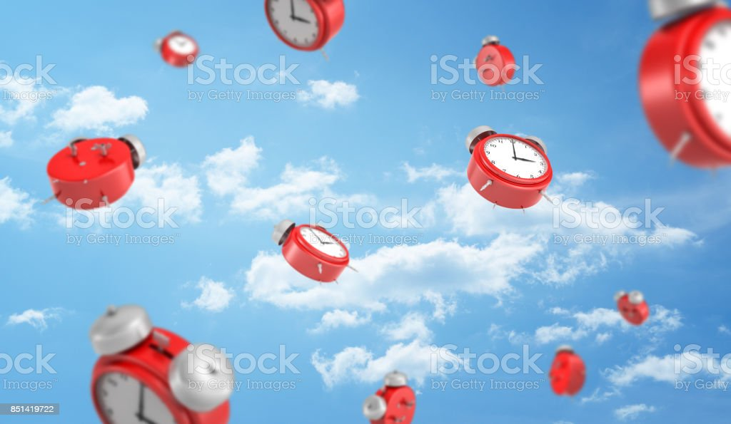 3d rendering of a many red retro-looking alarm clocks with metal bells fall down on cloudy sky background stock photo