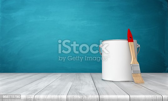 istock 3d rendering of a metal paint can on a wooden desk with a new clean brush leaning on its side. 868775790