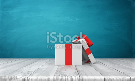 istock 3d rendering of a open white gift box with a red bow standing on a wooden desk in front of a blue background 845781732
