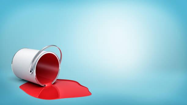 3d-rendering einer umgestürzten blecheimer mit roter farbe austritt in einer pfütze auf blauem hintergrund. - zinn farbe stock-fotos und bilder