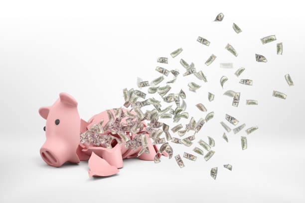3d rendering of a pink broken piggy bank lying on a white background with many dollar banknotes flying out of it. - bankruptcy stock pictures, royalty-free photos & images