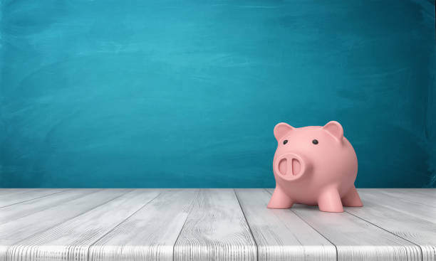 3d rendering of a pink piggy bank in front view standing on a wooden table stock photo