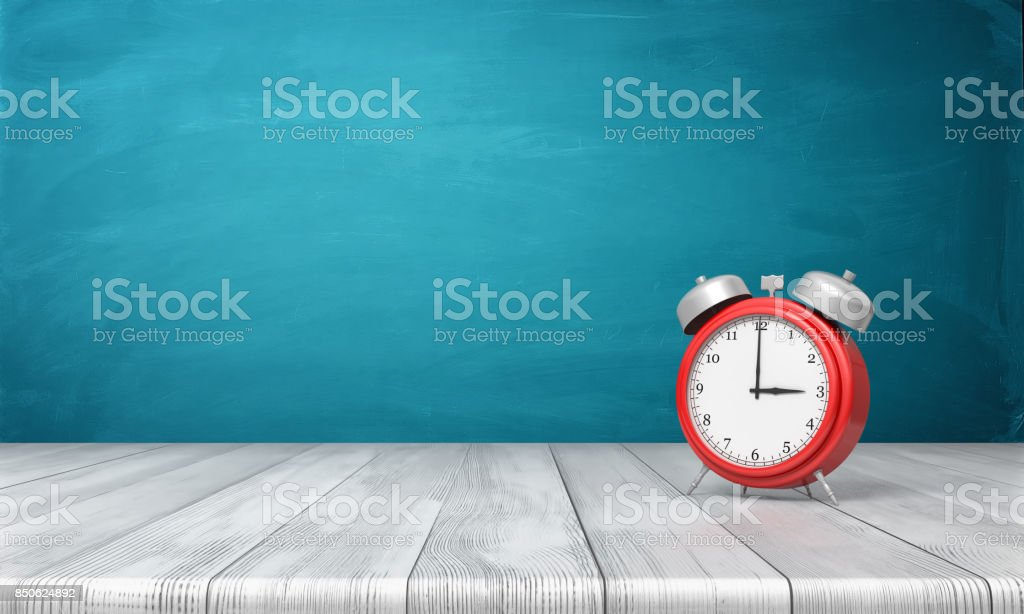 3d rendering of a red vintage alarm clock with metal bells stands on a wooden desk in front of blue background stock photo
