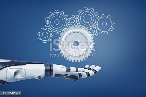 istock 3d rendering of a robot hand with its palm open and ready to catch a light-grey metal cogwheel and unfilled cogwheels of various shapes. 1178542371