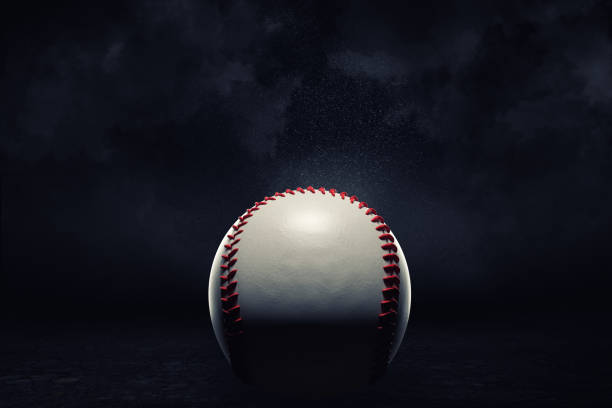 3d rendering of a single baseball ball in a close view under a spotlight on a dark background. - baseball стоковые фото и изображения