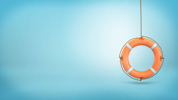 3d rendering of a single orange life buoy hangs down from a rope on a blue background stock photo