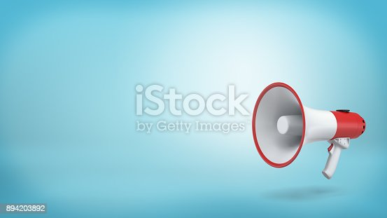 1055944594 istock photo 3d rendering of a single red and white electric megaphone with a handle stands on a blue background 894203892