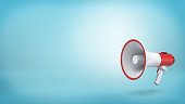 istock 3d rendering of a single red and white electric megaphone with a handle stands on a blue background 894203892