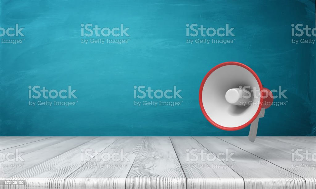 3d rendering of a single red and white megaphone hanging vertically above a wooden desk. stock photo