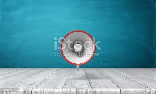 istock 3d rendering of a single red and white megaphone hanging vertically above a wooden desk 889296716