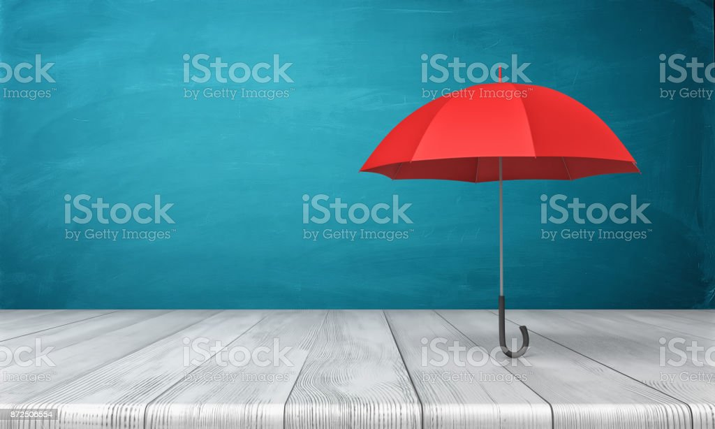 3d rendering of a single red classic umbrella with an open canopy standing above a wooden desk on blue background stock photo