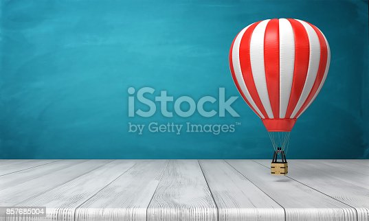 istock 3d rendering of a striped white and red hot air balloon hanging over a wooden desk on a blue background. 857685004