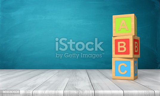 istock 3d rendering of a three toy blocks standing on a wooden desk in one tower with letters A, B and C on them. 869080608