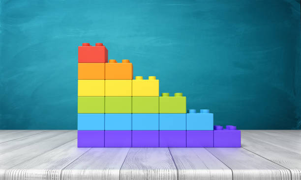 3d rendering of a toy building blocks arranged into rainbow colored stars on top of a wooden desk - toy block stock photos and pictures