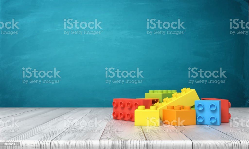 3d rendering of a toy building blocks lying in a colorful pile over a wooden desk on a blue background royalty-free stock photo