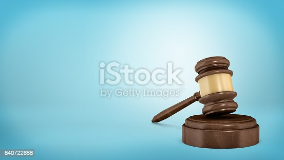 istock 3d rendering of an isolated dark wood judge gavel resting on a sound block 840722688