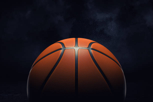 3d rendering of an orange rubber surface of a basketball ball shown on a black background. - basket foto e immagini stock