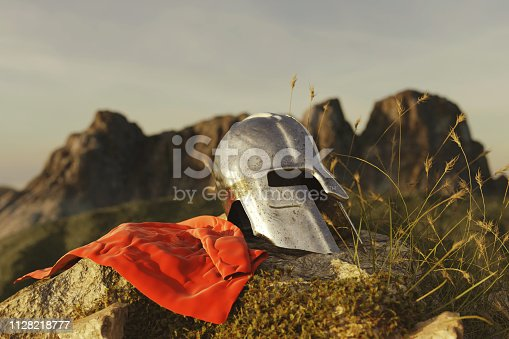 3d rendering of ancient greek Sparta type helmet with red cape laying on rocks in the evening sunset