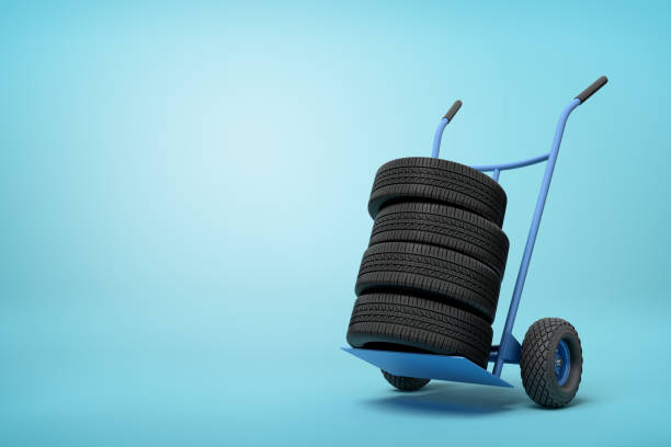 3d rendering of black vehicle tires on a hand truck on blue background