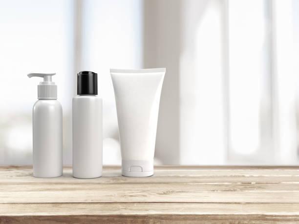 3d renderização de cosméticos mockup branco em branco definir uma garrafa de tampa de bomba, uma garrafa de tampa flip e um tubo de espremer em uma base de madeira com espaço para texto - squeeze bottle - fotografias e filmes do acervo