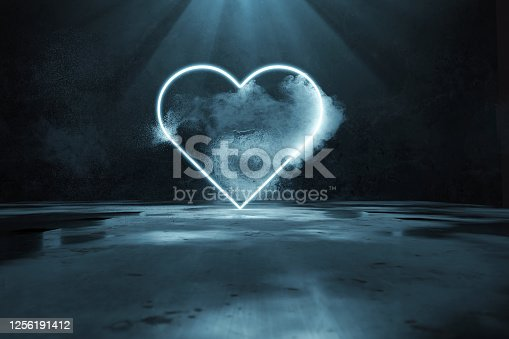 1039536404 istock photo 3d rendering of blue lighten heart shape with light rays in front of grunge wall background and puddles 1256191412