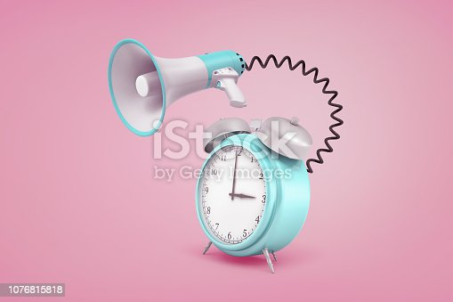 istock 3d rendering of blue retro alarm clock connected to a megaphone with a black cord on a pink background. 1076815818