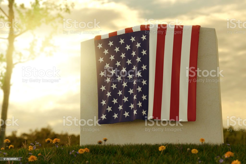 3d rendering of close up American flag laying on grave at the peaceful flower meadow to remember the memorial day stock photo