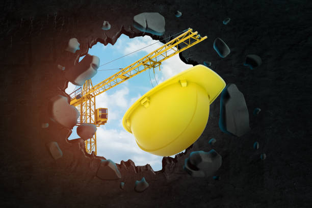 3d rendering of construction crane and yellow hard hat breaking black wall - under construction icon foto e immagini stock