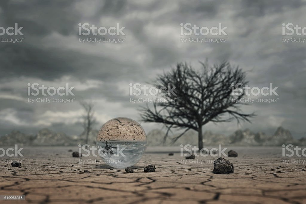 3d rendering of crystal ball at dry soil landscape stock photo