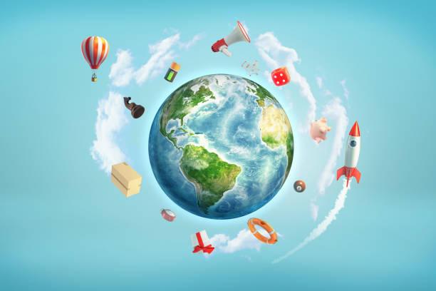 地球の 3 d レンダリングはサイコロ、電池、ビリヤードのボールが飛んでロケットのような大きなオブジェクトに囲まれて。 - アイコン プレゼント ストックフォトと画像