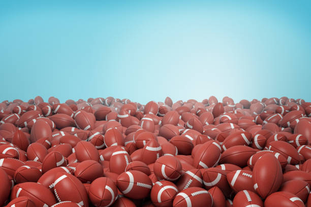 3d rendering of endless heap of identical red leather balls for American football on blue background. 3d rendering of endless heap of identical red leather balls for American football on blue background. Traditional sport. Team game. Equipment and gear for sport. medium group of objects stock pictures, royalty-free photos & images