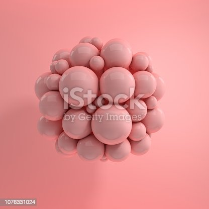 istock 3d rendering of floating polished spheres on pink background. Abstract geometric composition. Group of balls in pink pastel colors with soft shadows 1076331024