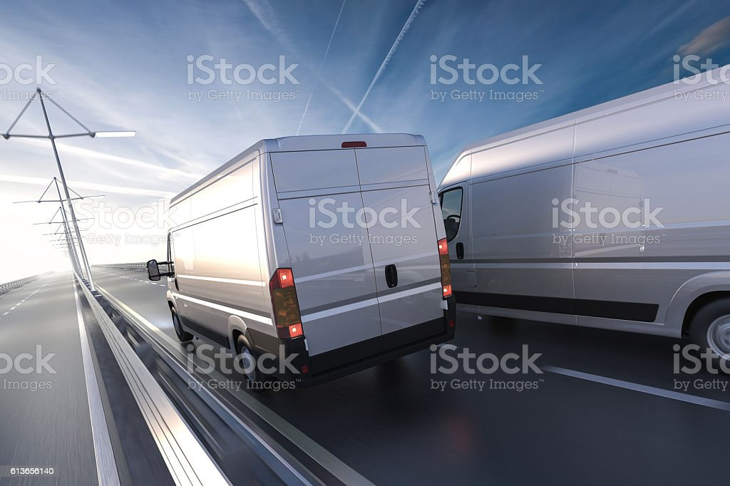 3d rendering of generic vans on the road at dawn stock photo