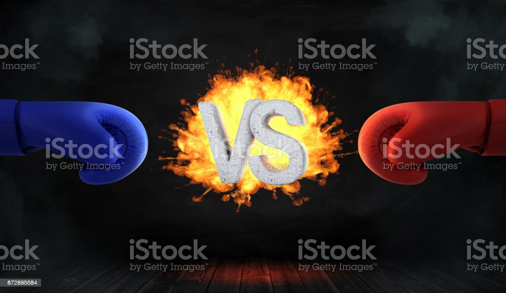 3d rendering of glowing blast with concrete letters VS stands between a red and a blue boxing glove. stock photo