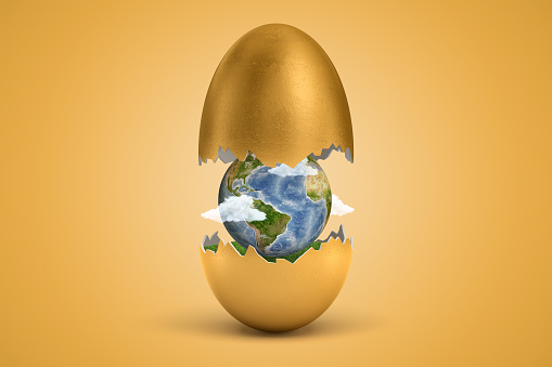 istock 3d rendering of gold egg cracked in two, lower half with green grass inside, upper half in air, with little Earth globe inside the shell. 1178729348
