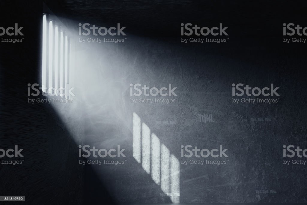 3d rendering of grunge prison cell with the shadows of stanchions projected on wall from light ray on window stock photo